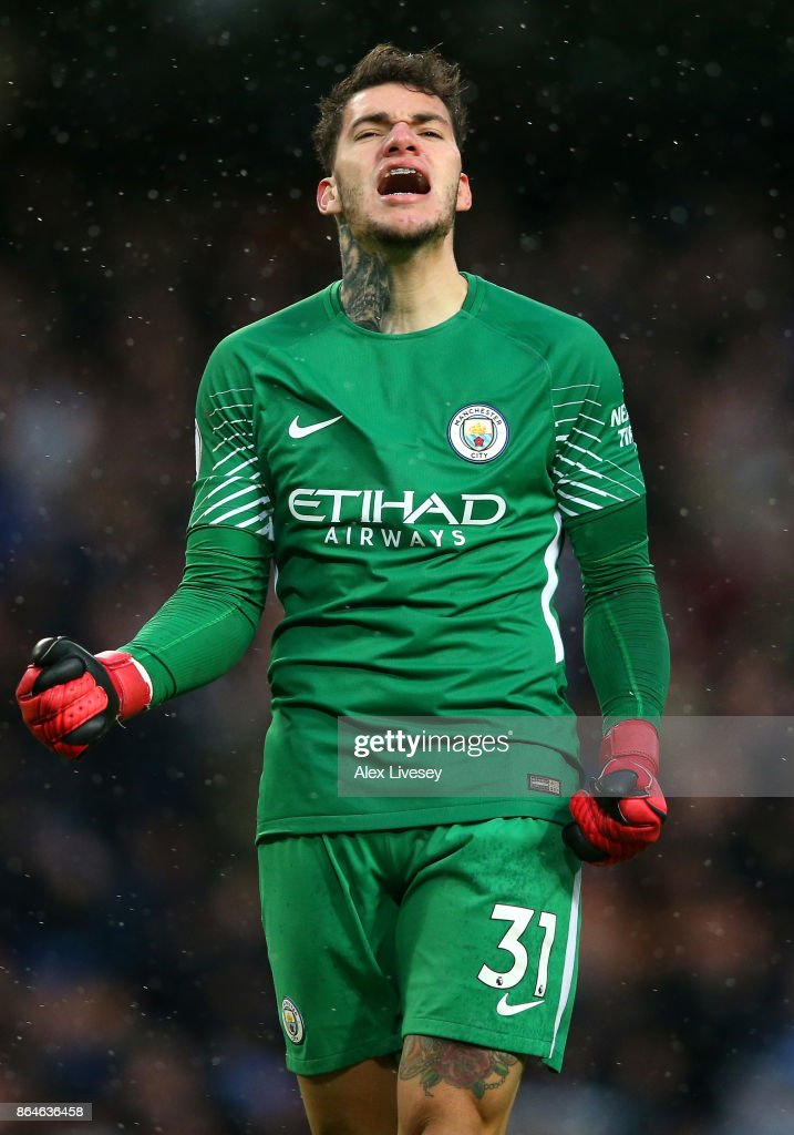 Ederson of Manchester City celebrates as Leroy Sane of Manchester City scores their third goal during the Premier League match between Manchester City and Burnley at Etihad Stadium on October 21, 2017 in Manchester, England.