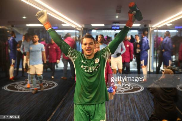 Ederson of Manchester City celebrates following his side's win during the Premier League match between Manchester City and Chelsea at Etihad Stadium...