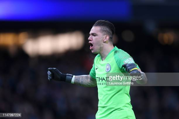 Ederson of Manchester City celebrates his sides first goal during the Premier League match between Manchester City and Leicester City at Etihad...