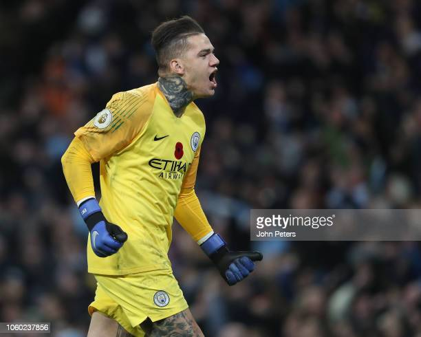 Ederson of Manchester City celebrates Ilkay Gundogan scoring their third goal during the Premier League match between Manchester City and Manchester...
