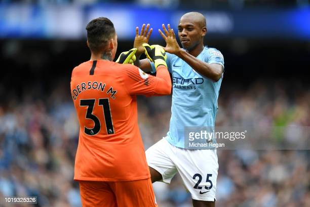 Ederson of Manchester City celebrates with Fernandinho of Manchester City after Sergio Aguero of Manchester City scores his sides first goal during...