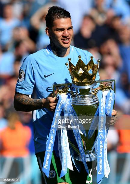 Ederson of Manchester City celebrates with The Premier League Trophy after the Premier League match between Manchester City and Huddersfield Town at...
