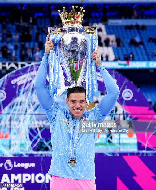 Ederson of Manchester City celebrates with the trophy during the Premier League match between Manchester City and Everton at Etihad Stadium on May...