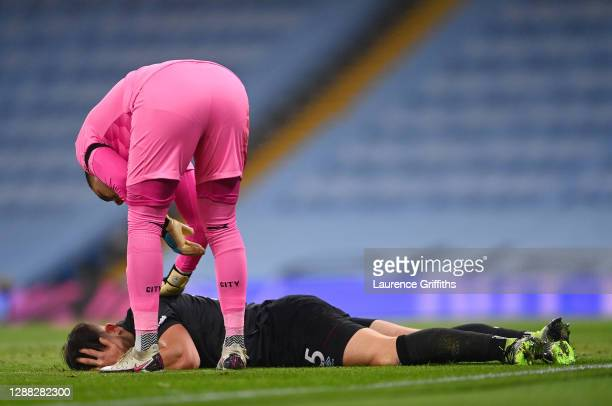Ederson of Manchester City checks on James Tarkowski of Burnley after a collision during the Premier League match between Manchester City and Burnley...