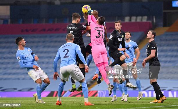 Ederson of Manchester City clashes with James Tarkowski of Burnley during the Premier League match between Manchester City and Burnley at Etihad...