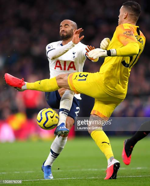 Ederson of Manchester City clashes with Lucas Moura of Tottenham Hotspur during the Premier League match between Tottenham Hotspur and Manchester...
