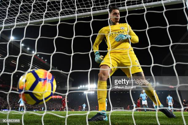 Ederson of Manchester City collect the ball from the back of the net after Sadio Mane of Liverpool scored the 3rd Liverpool goal during the Premier...
