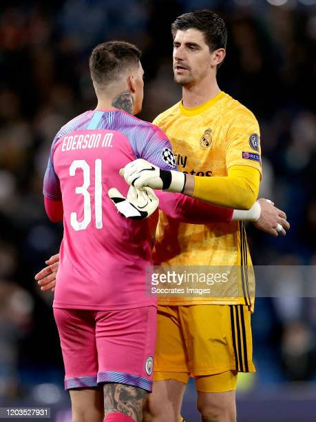 Ederson of Manchester City Courtois of Real Madrid during the UEFA Champions League match between Real Madrid v Manchester City at the Santiago...
