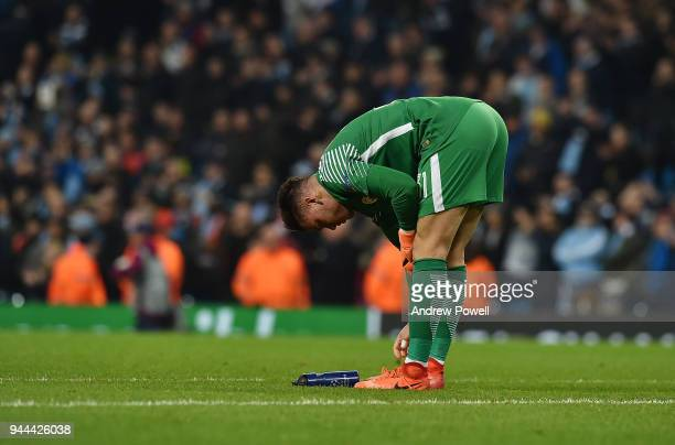 Ederson of Manchester City dejected at the end of the UEFA Champions League Quarter Final Second Leg match between Manchester City and Liverpool at...