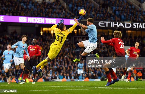 Ederson of Manchester City dives to make a save during the Premier League match between Manchester City and Manchester United at Etihad Stadium on...