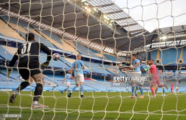 Ederson of Manchester City fails to save as Karim Benzema of Real Madrid scores Real Madrid's first goal during the UEFA Champions League round of 16...