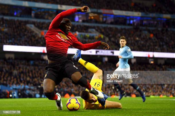 Ederson of Manchester City fouls Romelu Lukaku of Manchester United to concede a penalty during the Premier League match between Manchester City and...
