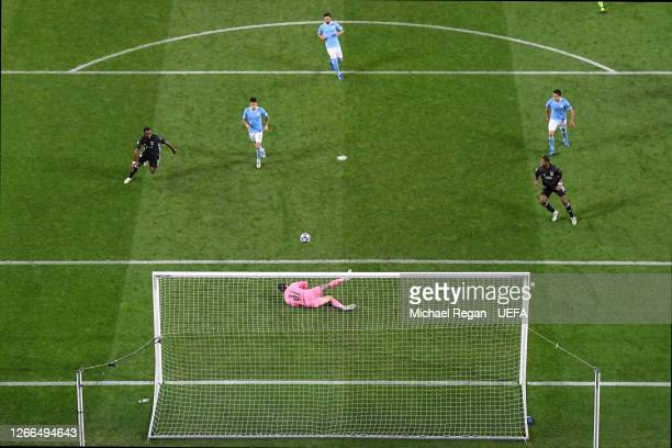 Ederson of Manchester City fumbles the ball leading to Moussa Dembele of Olympique Lyon scoring his team's third goal during the UEFA Champions...