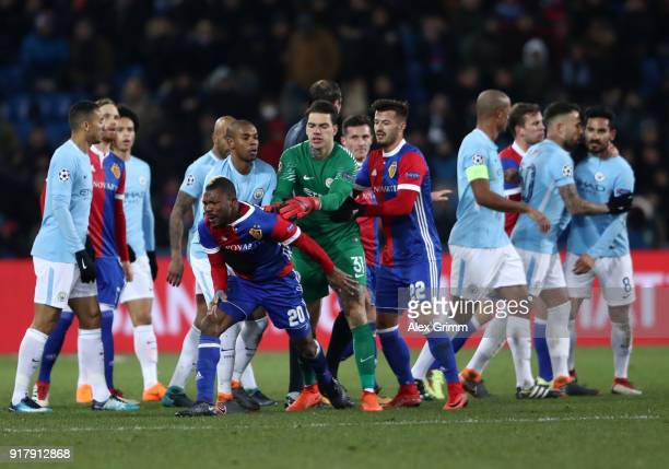 Ederson of Manchester City holds back Geoffroy Serey Die of FC Basel as he clashes with the Manchester City team during the UEFA Champions League...
