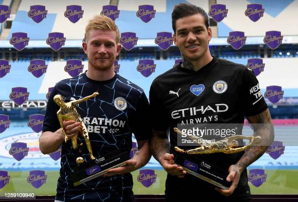 Ederson of Manchester City holds the Golden Glove Award and Kevin De Bruyne of Manchester City holds the Playmaker Award after the Premier League...