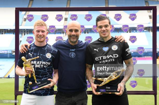 Ederson of Manchester City holds the Golden Glove Award and Kevin De Bruyne of Manchester City holds the Playmaker Award alongside Pep Guardiola,...