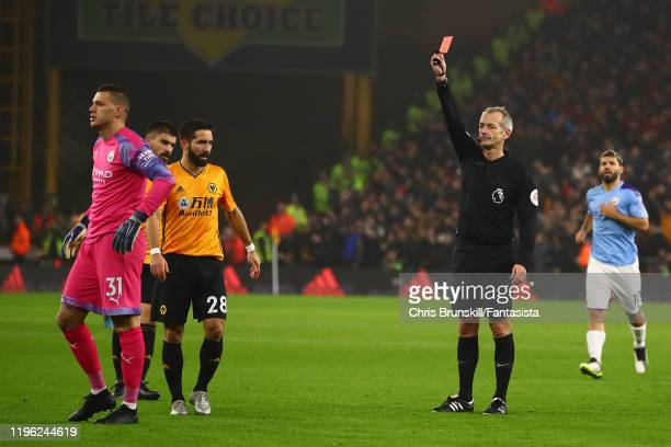 Ederson of Manchester City is sent off by referee Martin Atkinson during the Premier League match between Wolverhampton Wanderers and Manchester City...