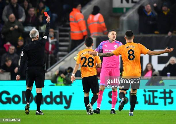 Ederson of Manchester City is shown a red card during the Premier League match between Wolverhampton Wanderers and Manchester City at Molineux on...