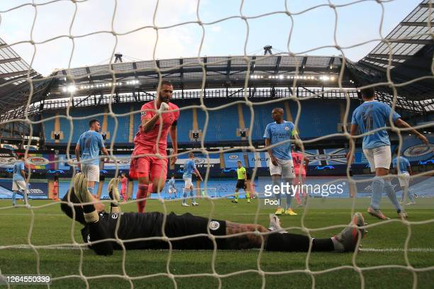 Ederson of Manchester City lies on the ground as Karim Benzema of Real Madrid celebrates after scoring his team's first goal during the UEFA...
