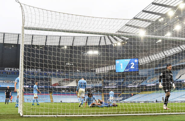 Ederson of Manchester City looks dejected after conceding a second goal scored by Marcos Alonso of Chelsea during the Premier League match between...