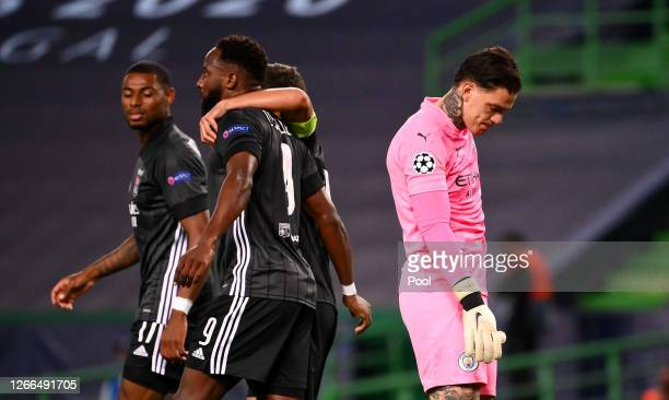 Ederson of Manchester City looks dejected as Moussa Dembele of Olympique Lyon celebrates after scoring his team's third goal during the UEFA...