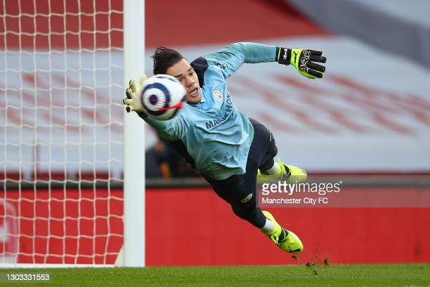 Ederson of Manchester City makes a save during the warm up prior to the Premier League match between Arsenal and Manchester City at Emirates Stadium...