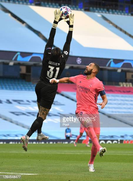 Ederson of Manchester City makes a save from Karim Benzema of Real Madrid during the UEFA Champions League round of 16 second leg match between...