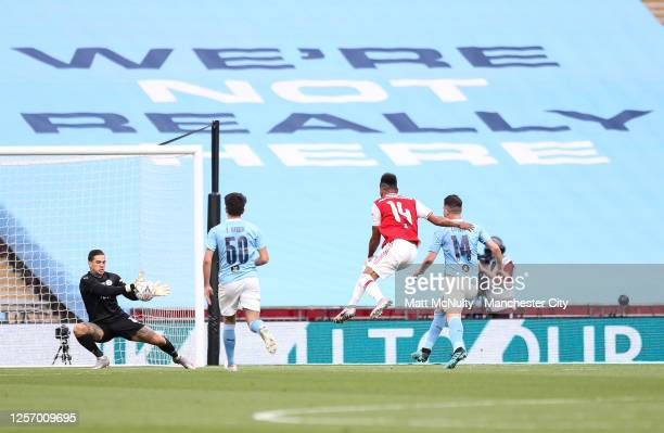 Ederson of Manchester City makes a save from PierreEmerick Aubameyang of Arsenal during the FA Cup Semi Final match between Arsenal and Manchester...