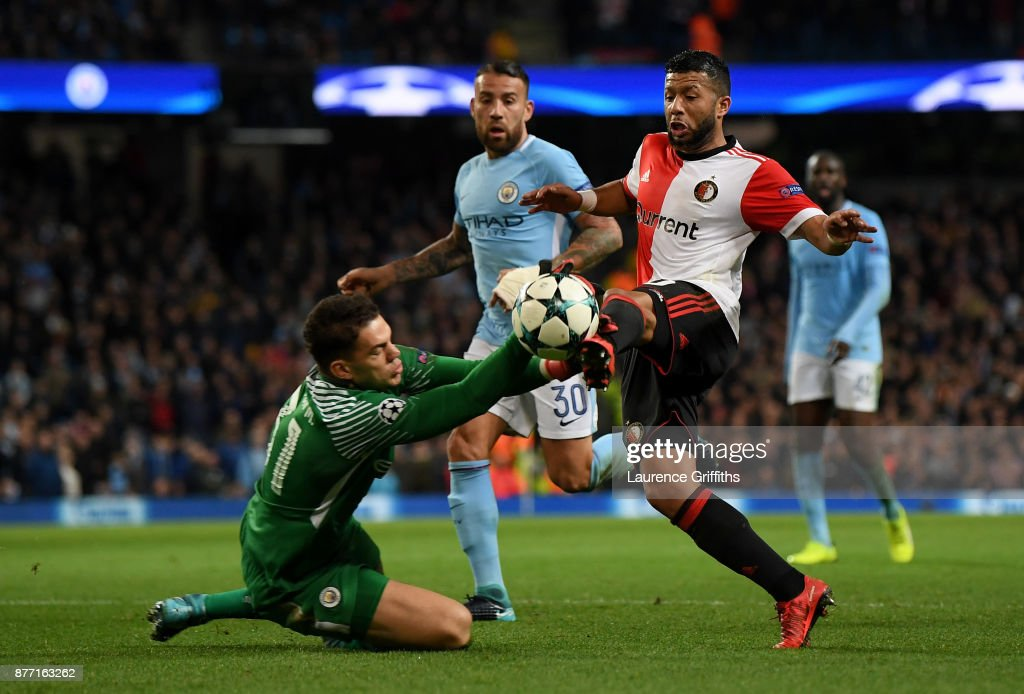 Ederson of Manchester City makes a save from Tonny Vilhena of Feyenoord during the UEFA Champions League group F match between Manchester City and Feyenoord at Etihad Stadium on November 21, 2017 in Manchester, United Kingdom.