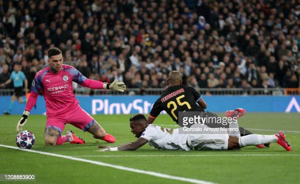 Ederson of Manchester City makes a save from Vinicius Junior of Real Madrid who is under pressure from Fernandinho of Manchester City during the UEFA...