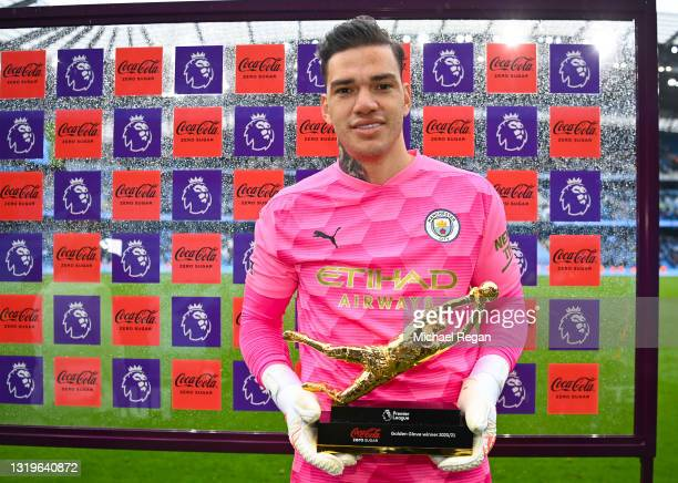 Ederson of Manchester City poses with his Coca-Cola Zero Sugar Golden Glove Winner award following his team's victory in the Premier League match...