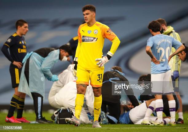 Ederson of Manchester City reacts as Eric Garcia of Manchester City receives medical treatment during the Premier League match between Manchester...