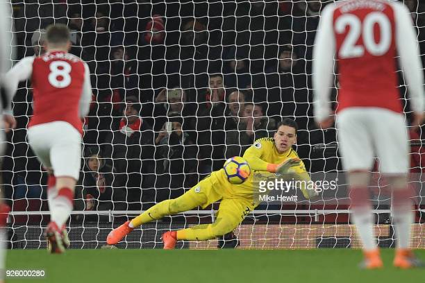 Ederson of Manchester City saves a penalty from Pierre-Emerick Aubameyang during the Premier League match between Arsenal and Manchester City at...