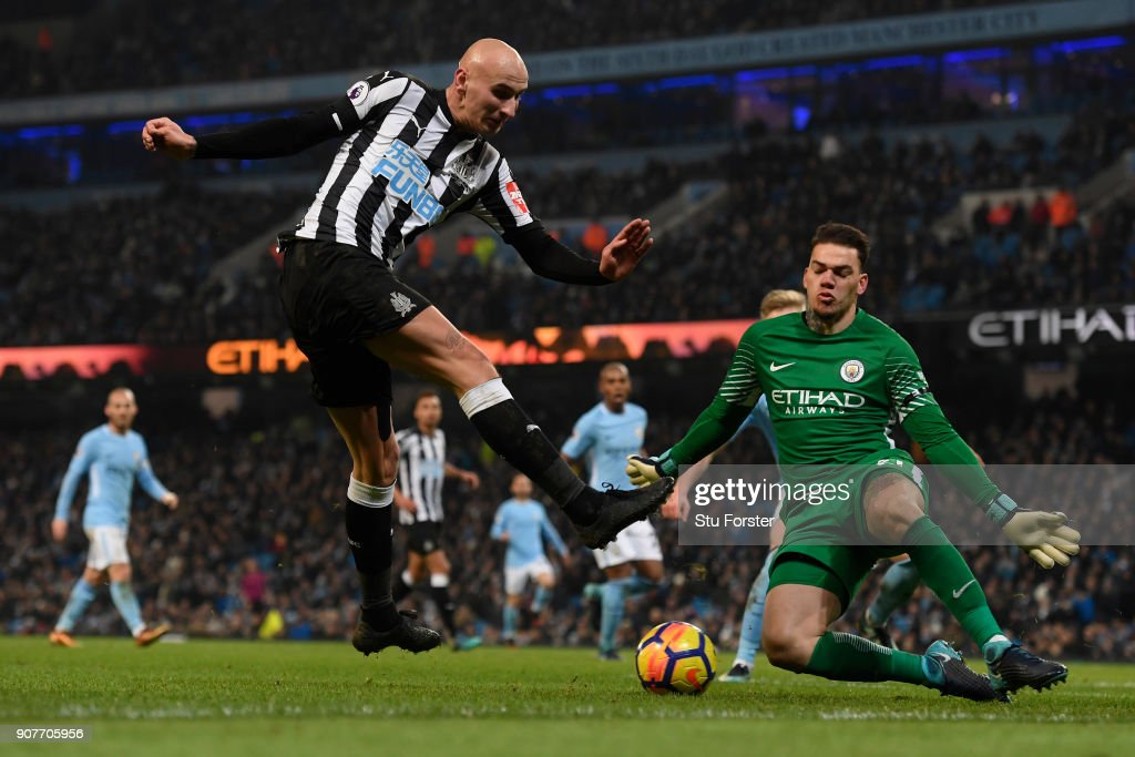 Ederson of Manchester City saves a shot from Jonjo Shelvey of Newcastle United during the Premier League match between Manchester City and Newcastle United at Etihad Stadium on January 20, 2018 in Manchester, England.