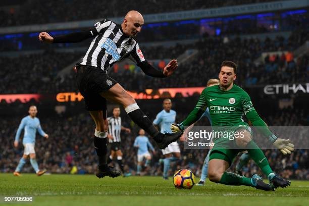 Ederson of Manchester City saves a shot from Jonjo Shelvey of Newcastle United during the Premier League match between Manchester City and Newcastle...