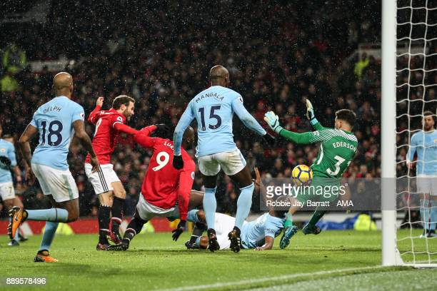 Ederson of Manchester City saves from Juan Mata of Manchester United during the Premier League match between Manchester United and Manchester City at...