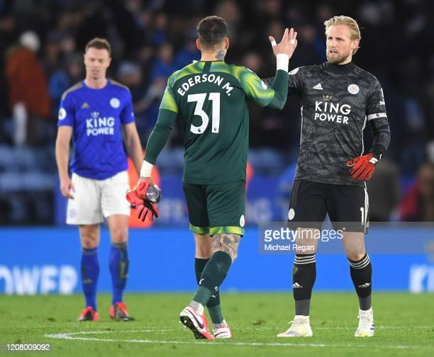 Ederson of Manchester City shakes hands with Kasper Schmeichel of Leicester City after the Premier League match between Leicester City and Manchester...