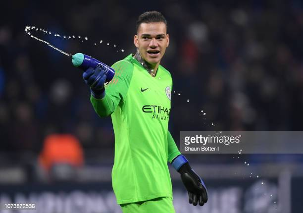 Ederson of Manchester City squirts water during the UEFA Champions League Group F match between Olympique Lyonnais and Manchester City at Groupama...