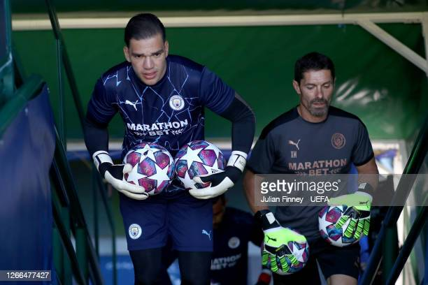 Ederson of Manchester City walks out for the warm up prior to the UEFA Champions League Quarter Final match between Manchester City and Lyon at...