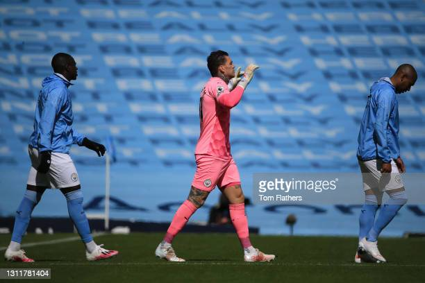 Ederson of Manchester City walks out onto the pitch prior to the Premier League match between Manchester City and Leeds United at Etihad Stadium on...