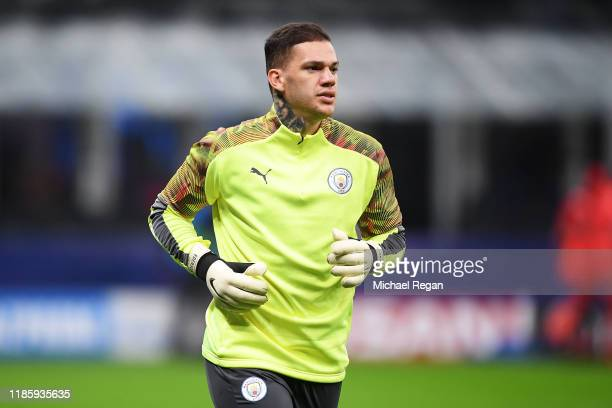 Ederson of Manchester City warms up ahead of the UEFA Champions League group C match between Atalanta and Manchester City at Stadio Giuseppe Meazza...