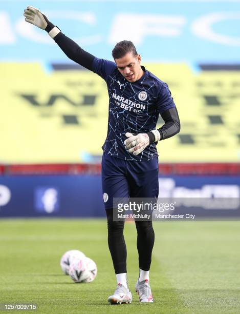 Ederson of Manchester City warms up during the FA Cup Semi Final match between Arsenal and Manchester City at Wembley Stadium on July 18 2020 in...