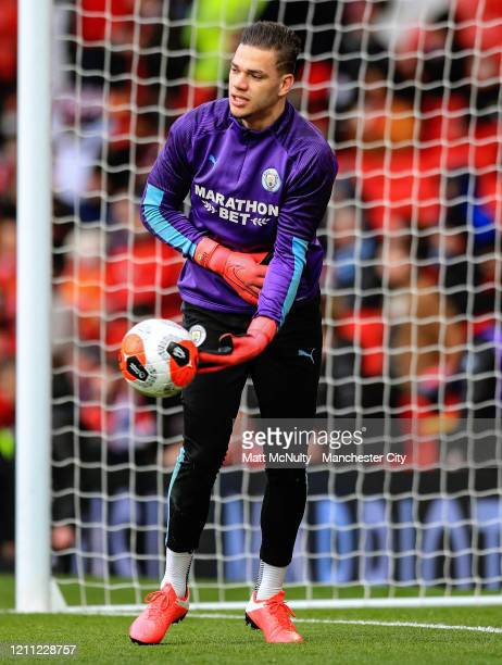 Ederson of Manchester City warms up during the Premier League match between Manchester United and Manchester City at Old Trafford on March 08 2020 in...