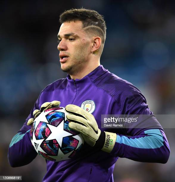 Ederson of Manchester City warms up prior to the UEFA Champions League round of 16 first leg match between Real Madrid and Manchester City at...