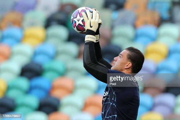 Ederson of Manchester City warms up prior to the UEFA Champions League Quarter Final match between Manchester City and Lyon at Estadio Jose Alvalade...