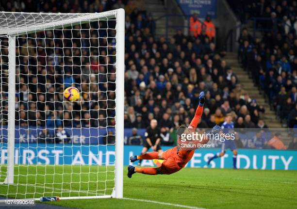 Ederson of Manchester City watches as Ricardo Pereira of Leicester City shot goes past him for Leicester City second goal during the Premier League...