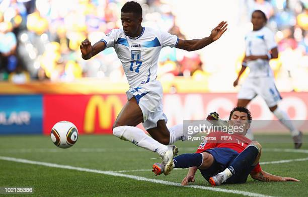 Edgar Alvarez of Honduras is tackled by Gary Medel of Chile during the 2010 FIFA World Cup South Africa Group H match between Honduras and Chile at...
