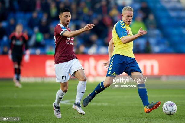 Edgar Babayan of Hobro IK and Hjötur Hermannsson of Brondby IF compete for the ball during the Danish Alka Superliga match between Brondby IF and...