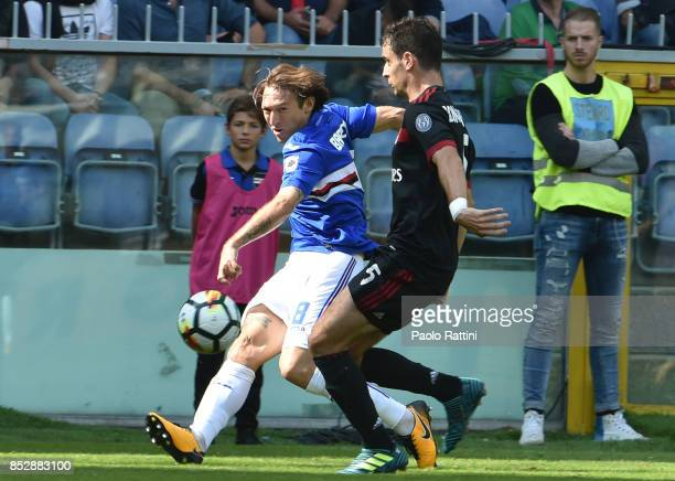 Edgar Barreto and Giacomo Bonaventura during the Serie A match between UC Sampdoria and AC Milan at Stadio Luigi Ferraris on September 24 2017 in...