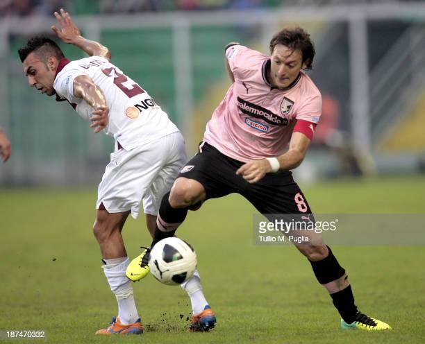 Edgar Barreto of Palermo and Desiderio Garufo of Trapani compete for the ball during the Serie B match between US Citta di Palermo and Trapani Calcio...